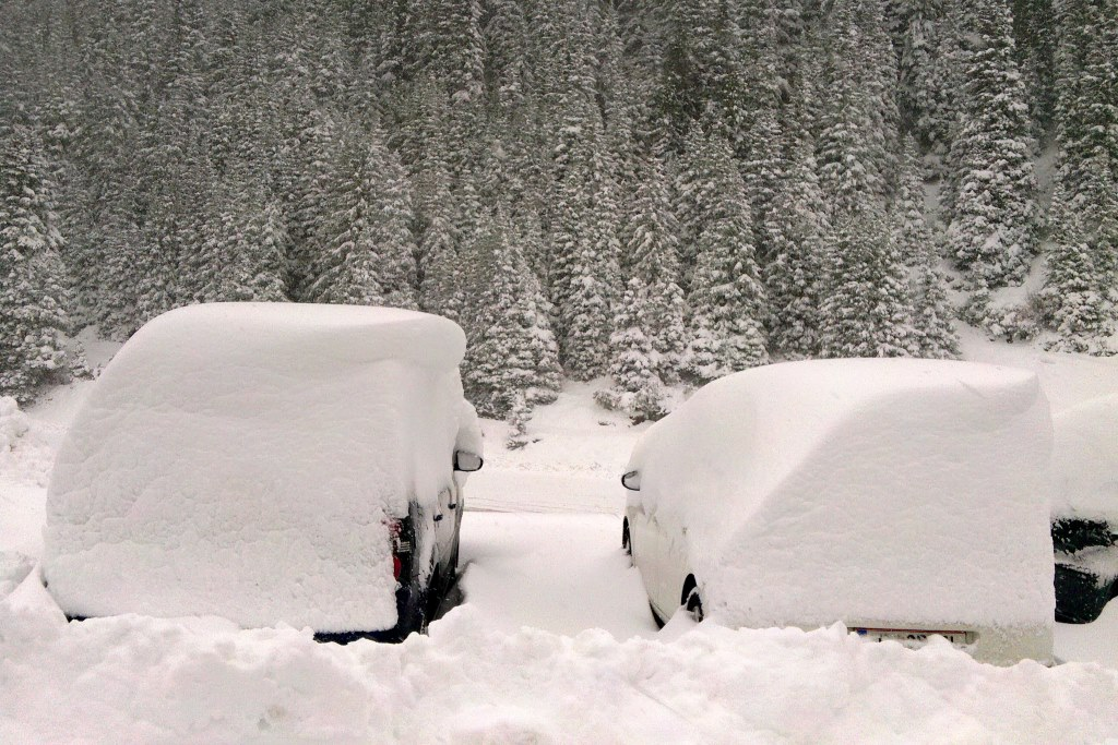 Cars buried under snow
