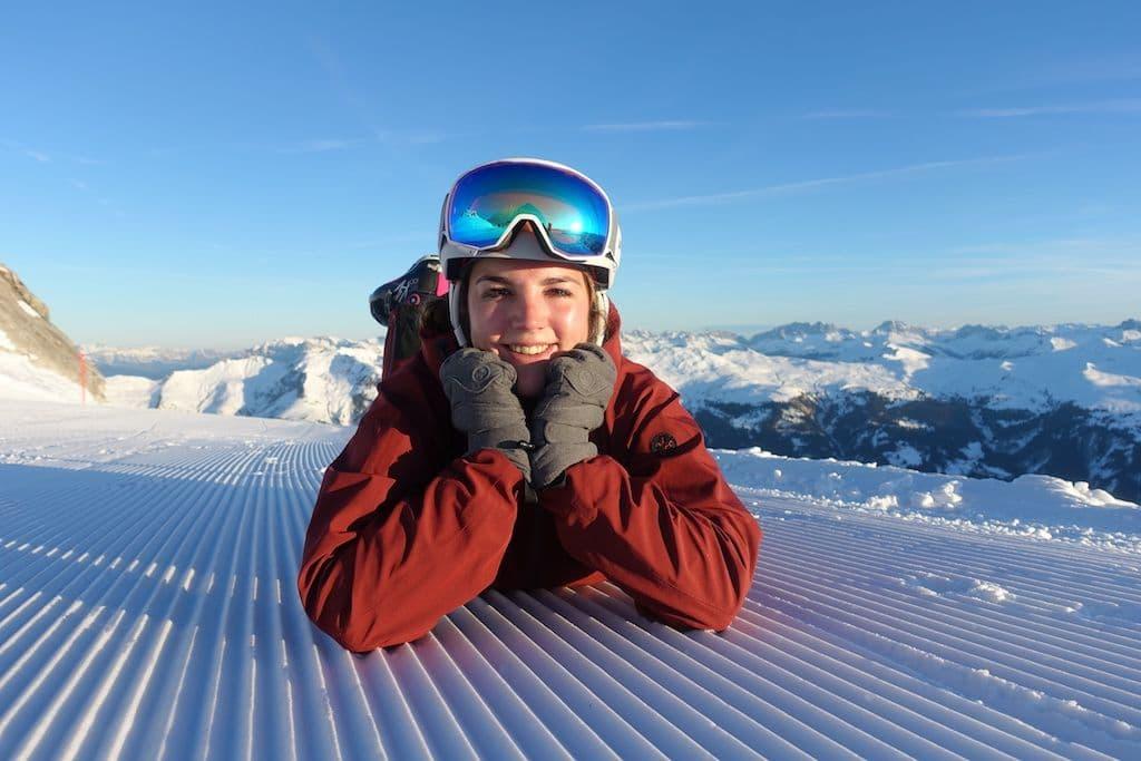 happy skier on freshly groomed piste