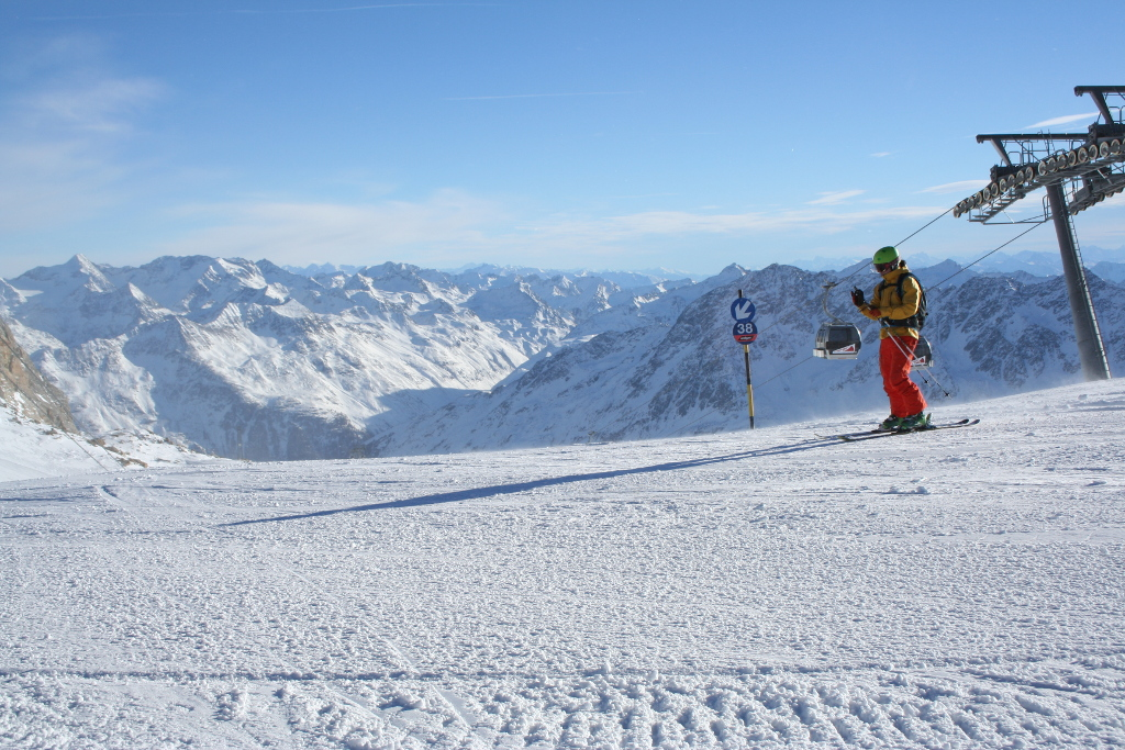 Soelden ski area with skier and blue piste
