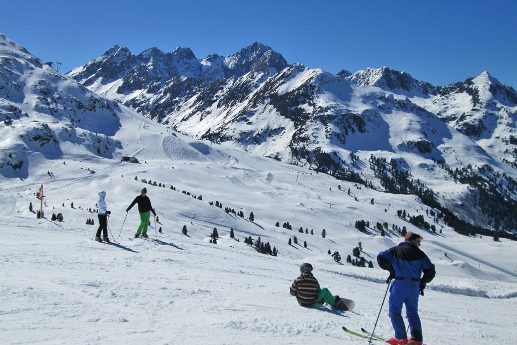 Sunny spring skiing holiday with fresh snow
