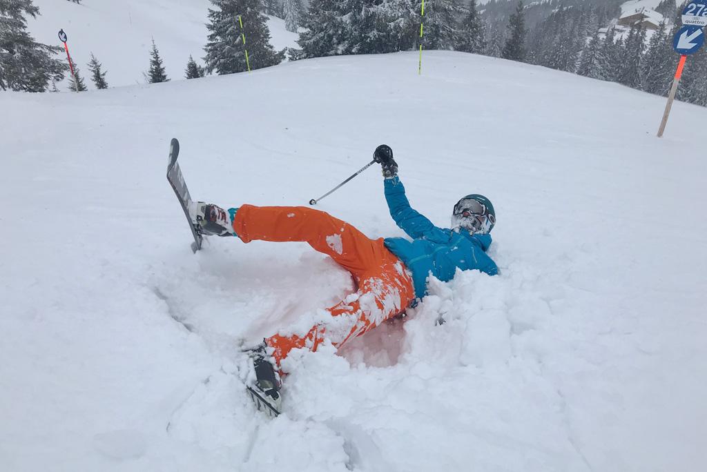 fallen skier in powder snow