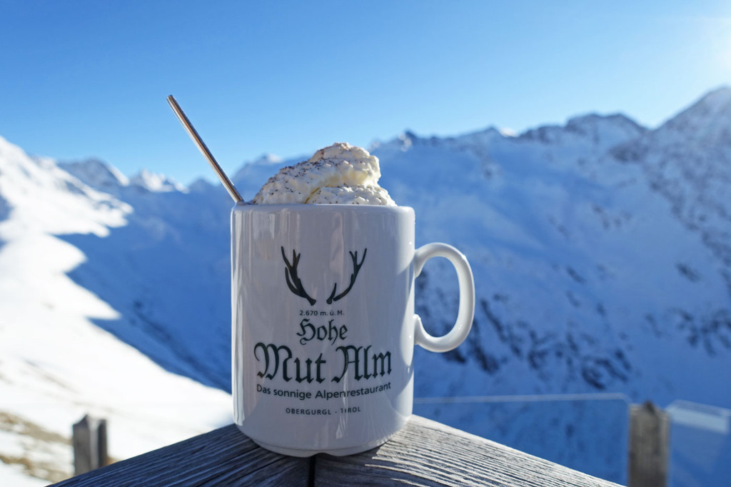 hot chocolate against mountain backdrop