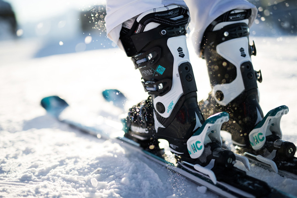 atomic ski boots on skis in snow