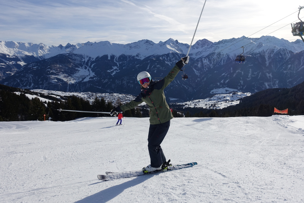 Having fun learning to ski skier with poles in air