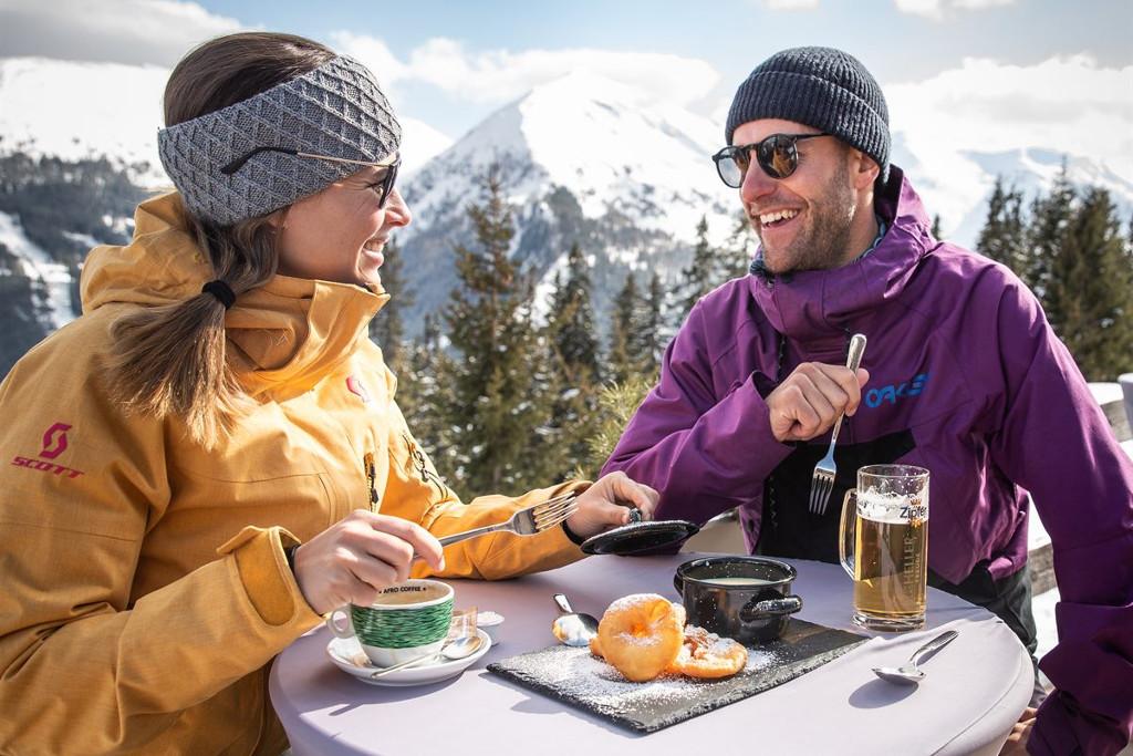 Skiers having lunch