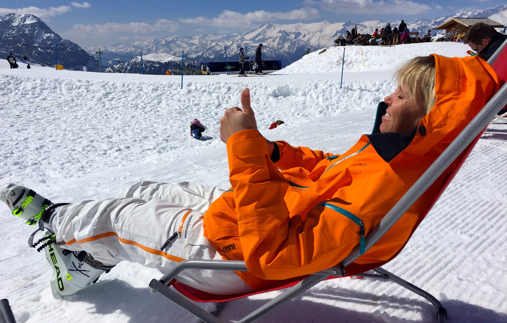 relaxing in a sun lounger during your ski holiday