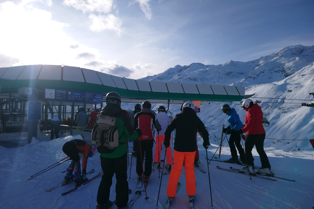 Skiers queueing for lift