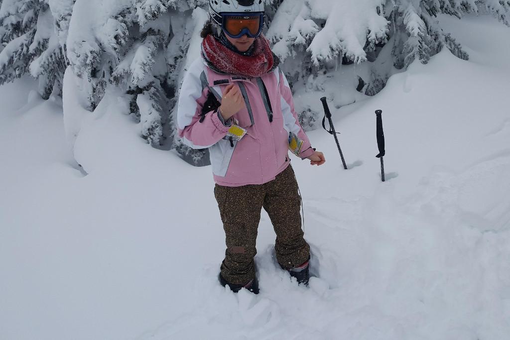 Skier knee-deep in powder at Sun Peaks