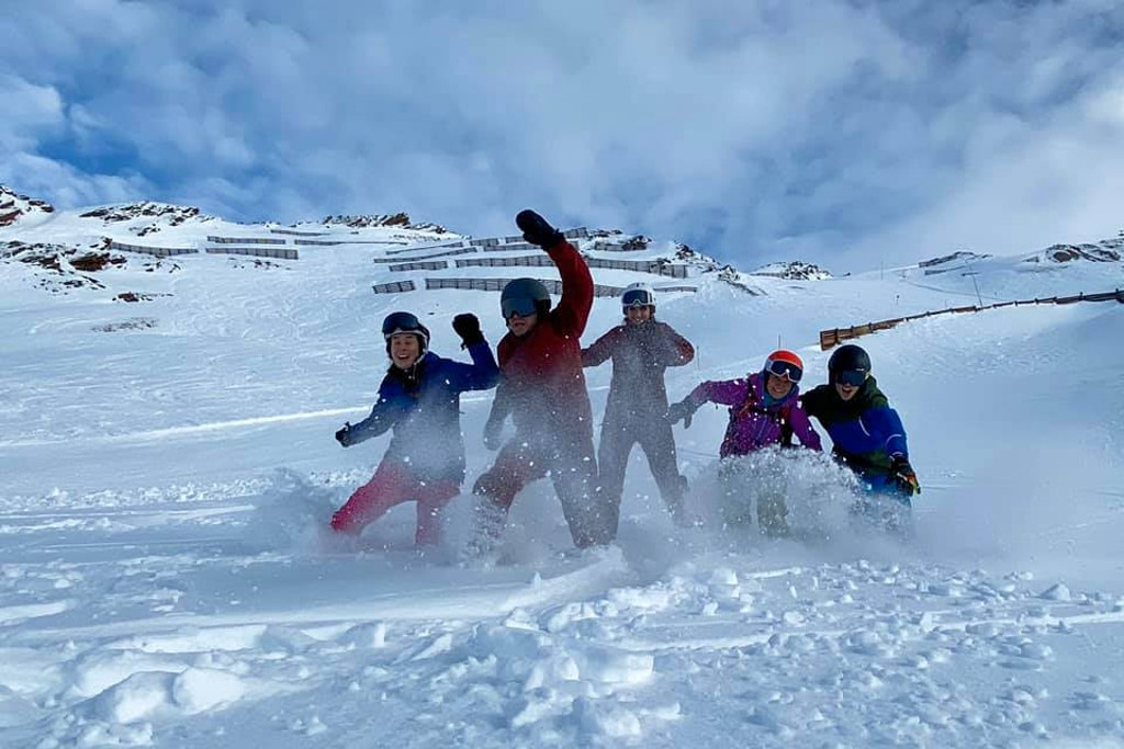 group of happy healthy skiers