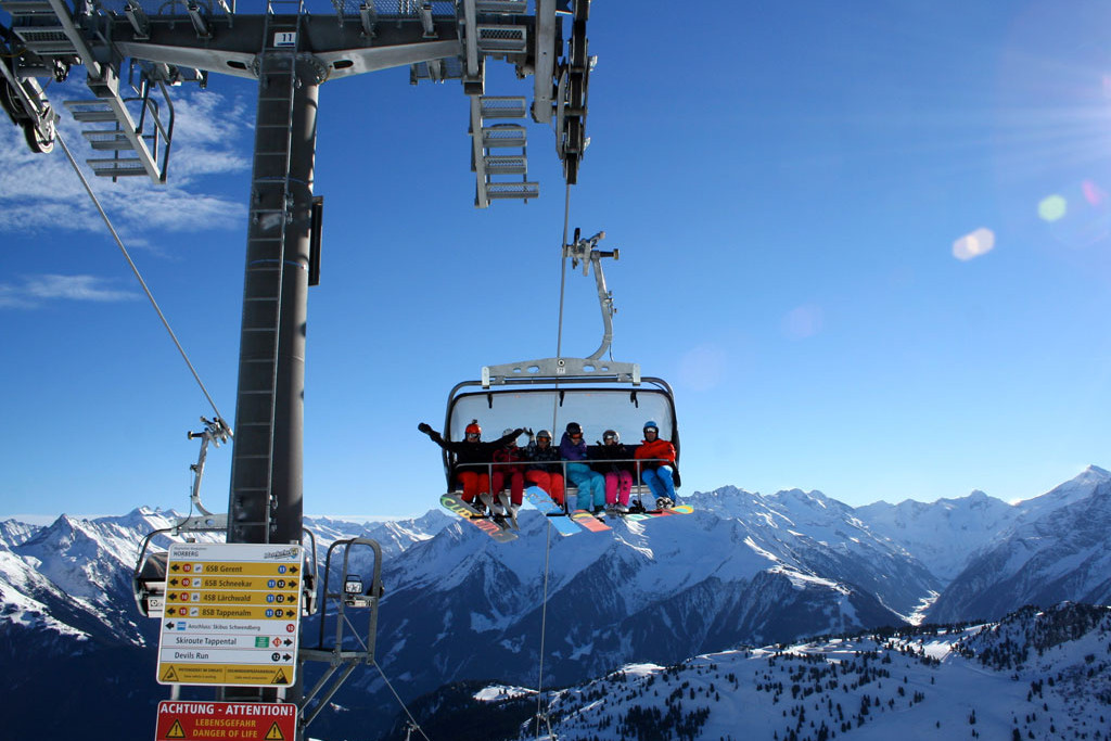 skiers on chairlift in mayrhofen
