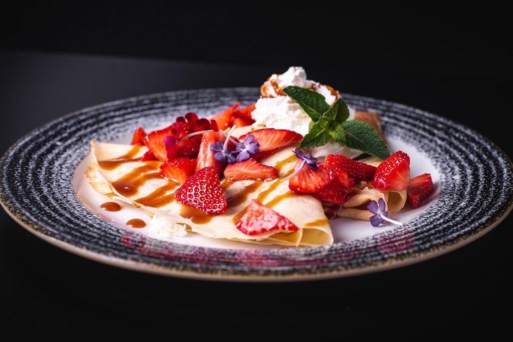 Crepe met aardbeien en slagroom
